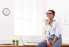 Business woman working on laptop at office. Businesswoman in modern office. Happy smiling woman working on laptop at office, copy space Stock Photo