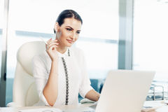 Business woman working on laptop royalty free stock image