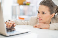 Business woman working with laptop in office Royalty Free Stock Images