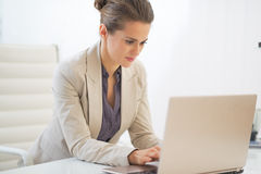Business woman working on laptop in office Stock Photography