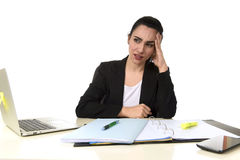 Business woman working on laptop at office in stress suffering intense headache migraine Stock Photography