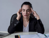 Business woman working on laptop at office in stress suffering intense headache migraine Royalty Free Stock Images