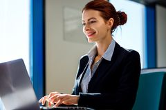 Business woman working on laptop in the office. royalty free stock photography