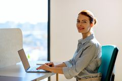 Business woman working on laptop in the office. royalty free stock image
