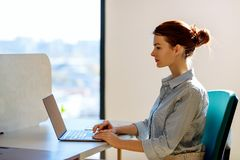 Business woman working on laptop in the office. royalty free stock images