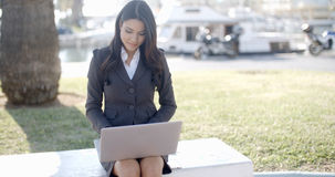 Business Woman Working On Laptop Outdoor Stock Photo