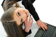 Business Woman Working on Laptop. Business woman working on a laptop shot from high angle Royalty Free Stock Image