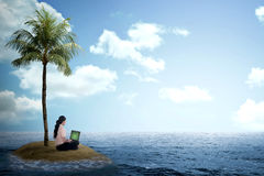 Business woman working with laptop on the small island Royalty Free Stock Photo