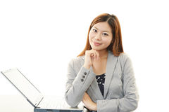 Business woman working on laptop. Smiling business woman using laptop Royalty Free Stock Photo