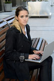 Business woman working on a laptop. Stock Photography