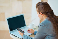 Business woman working with laptop on terrace Stock Photo