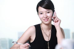 Business woman working with mobile phone Stock Image