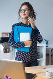 Business woman working with mobile phone in her office. Stock Images