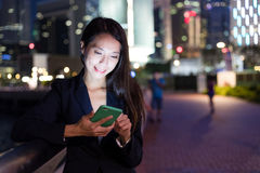 Business woman working on mobile phone at night Royalty Free Stock Photo