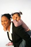 Business Woman - Working Mother. Image of an african american business woman with her child, conceptual working mother issues royalty free stock image