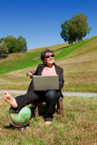 Business woman working in the nature Stock Image