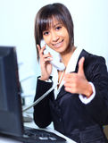 Business woman working in office. A business woman working in office Stock Image