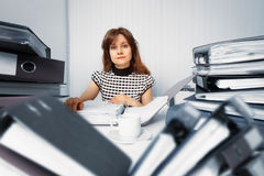 Business woman working in office with documents. Business woman working in the office with accounting documents Royalty Free Stock Photos