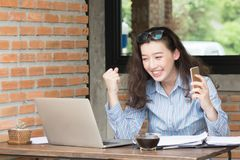 young business woman cheerful smile sitting at terrace cafe, enjoying online communication using free wireless internet connection royalty free stock image
