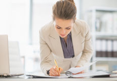 Business woman working in office with documents. Business woman working in modern office with documents stock photos