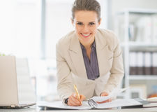Business woman working in office with documents Stock Images