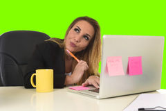 Business woman working at office laptop computer isolated green chroma key screen. Attractive 40s blond business woman working at office laptop computer sitting Stock Image