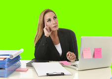 Business woman working at office laptop computer isolated green chroma key screen. Attractive 40s blond business woman working at office laptop computer sitting Royalty Free Stock Images