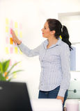 Business woman working in the office posted stickers Royalty Free Stock Photo