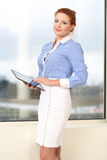 Business woman working in office. Raindrops on the window Stock Photo