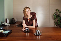 Business woman working at the office and smiling Stock Photography