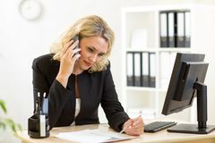 Business woman working in office. Worker talking Stock Image