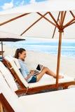 Business Woman Working Online On Beach. Freelance Computer Internet Stock Photo