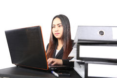 Business woman working online on a laptop Stock Image