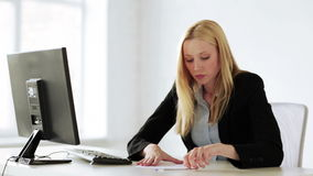 Business woman working with papers in office stock video