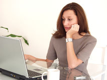 Business Woman working on PC. Young, professional looking business woman working at a notebook Royalty Free Stock Image