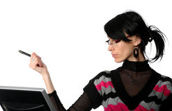 Business woman working and points toward the pen Stock Photos