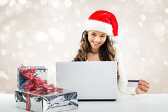 Business woman  working in Santa Claus hat Stock Photos