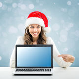 Business woman  working in Santa Claus hat Stock Photo
