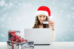 Business woman  working in Santa Claus hat Stock Image