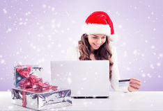 Business woman  working in Santa Claus hat Royalty Free Stock Photos