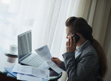 Business woman working and speaking mobile. At hotel room Stock Photo