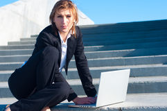 Business woman working on stairs Stock Photos