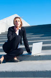 Business woman working on stairs, vertical Royalty Free Stock Photos