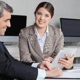 Business woman working with tablet Royalty Free Stock Photos