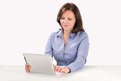 Business woman is working with tablet computer Stock Images