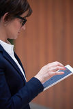Business woman working on tablet Stock Images