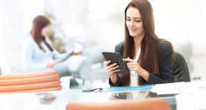 Business woman working with tablet in office. Young  women working with tablet in office Royalty Free Stock Images