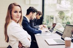 Business woman working with business team by laptop computer. Be Royalty Free Stock Images