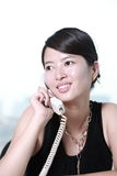 Business woman working with telephone Royalty Free Stock Photos