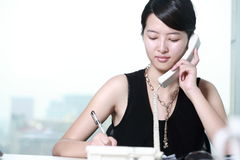 Business woman working with telephone Stock Images